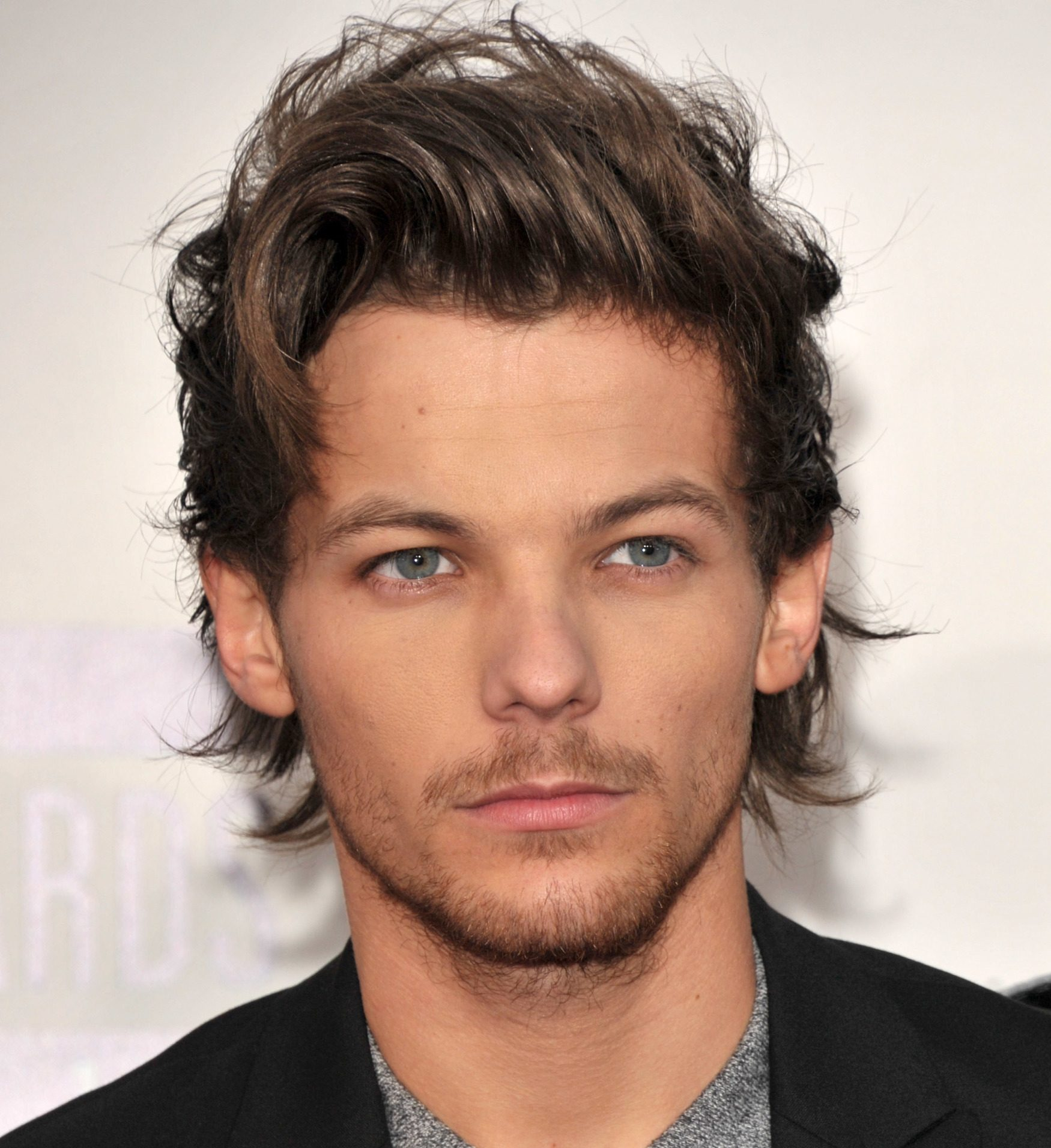 Louis Tomlinson Grew Up Fast Due To One Direction Fame